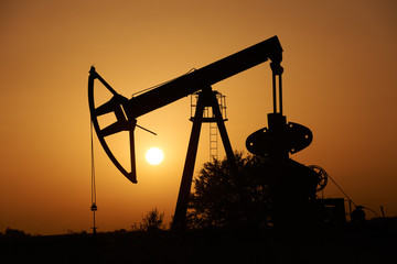 Oil pump and Sun at sunset