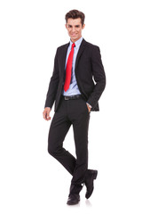 business man standing with hand in pocket