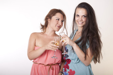 Two beautiful young girls with cocktails