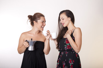 Two attractive women drinking coffee