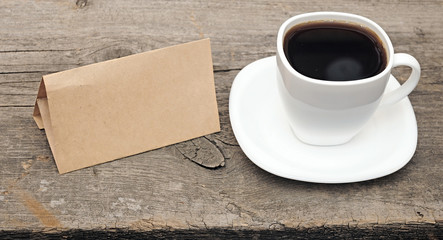blank old paper with coffee cup on wooden background