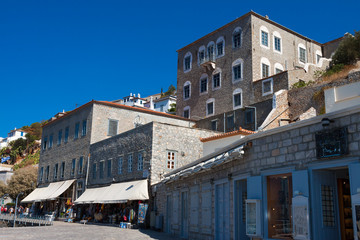Old stone houses by port at traditional greek island