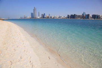 Beach and the skyline of Abu Dhabi, UAE