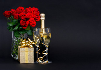 red roses and champagne with golden decoration