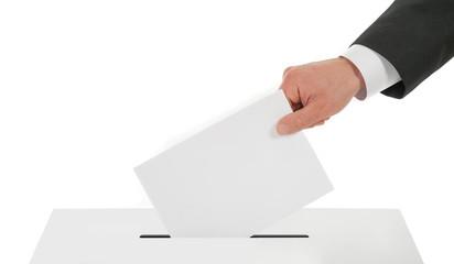 Man hand down the ballot in the ballot box