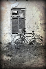 old bicycle. Photo in old image style.