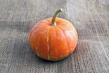 decorative pumpkin on sacking burlap