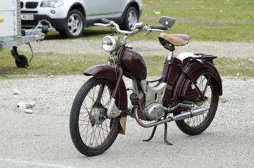 Vintage old retro brown motorbike staying on the street