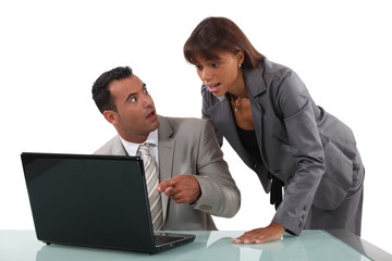 businessteam surprised of what they see on the laptop