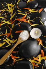Salt in wooden spoon with flower petals