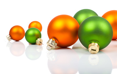 Multi-colored Christmas ornaments - orange and  green, on a whit