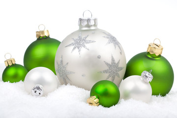 Christmas ornaments with snow - white and green , on a white