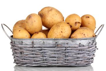 Ripe potatoes on basket isolated on white