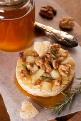 Baked Camembert  with toasted bread, rosemary and nuts