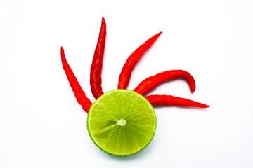 Wall Mural - Fresh ripe lime and red hot chili pepper. Isolated on white back
