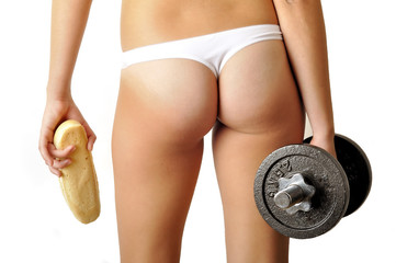 Girl ass with two hands holding dumbbell and long white loaf