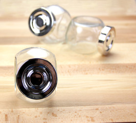 Glass Jars on a wooden background
