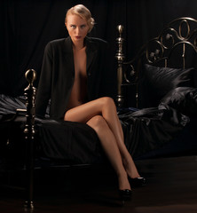 fashion model on a bed