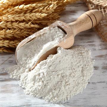 plain flour in wooden scoop