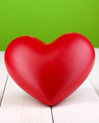 Photo sur Aluminium Graffiti collage Decorative red heart on white wooden table on green background