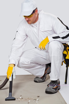 Cleaning cement floor with vacuum cleaner