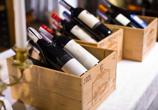 Wine bottles in wooden boxes.