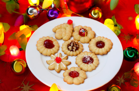 Spritz cookies filled with jam and decoration for  Christmas