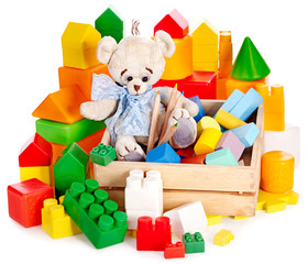 Teddy bear and cubes. Children toys.