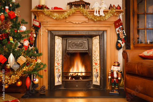 three chicks are fucking next to the fireplace on christmas  269200