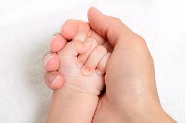 Mother holding a baby hand