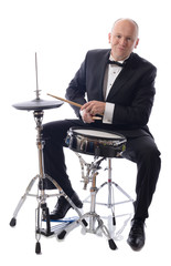tuxedo playing drums