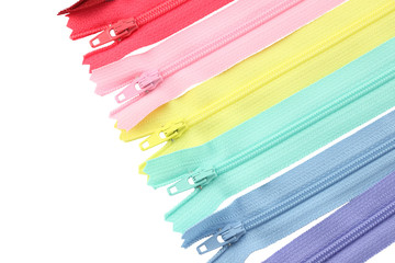 Multiple row of zippers on white background.