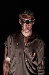 The zombie  in browm shirt looking