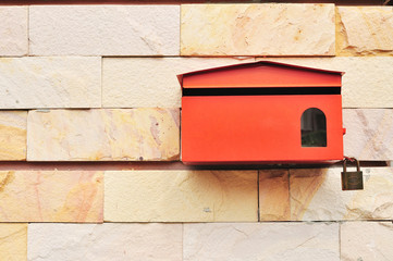 Red Postbox on wall of Sandstone