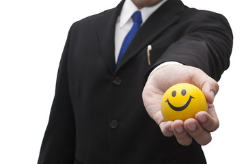 Business man give smily ball on white (Positive Theme)