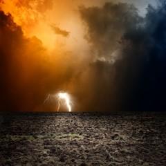 Fototapete - Arable field, dark sky