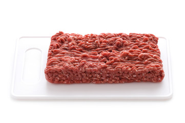 minced beef on a white chopping board isolated