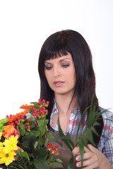 Young brunette with flowers