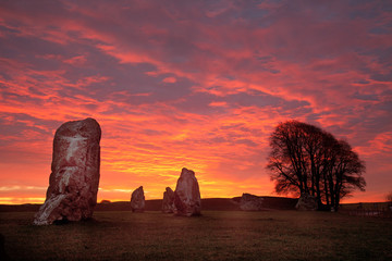 Poster de jardin Artistique Avebury Stone Circle and Henge at sunrise Wiltshire England UK