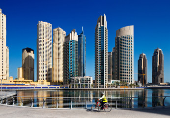 A cyclist cycles the Marina walk, Dubai Marina and JBR