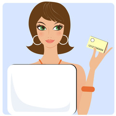 Young brunette with credit card shopping on internet