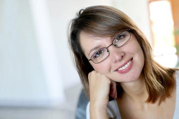 Smiling brunette woman wearing eyeglasses