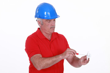 craftsman holding a screwdriver and an electric socket