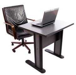 Laptop on desk near a leather armchair