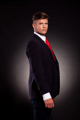 business man posing with red tie