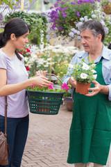 Woman talking to garden center employee