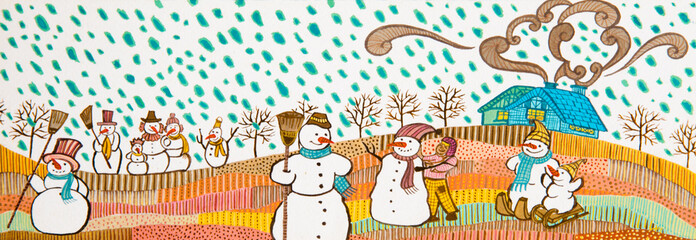 Snowmans in the snow.