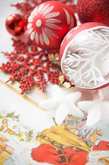 Red and white xmas baubles on holiday background