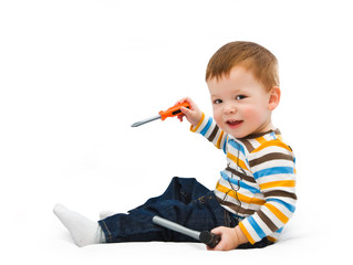 One-year-old child with a screw-driver and a hammer