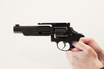 gun in hand against white background